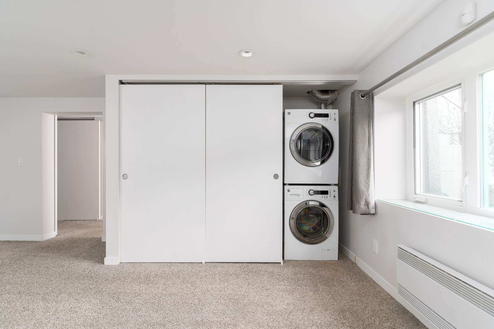 Basement suite equipped with washer and dryer in a basement suite managed by Birds Nest Properties