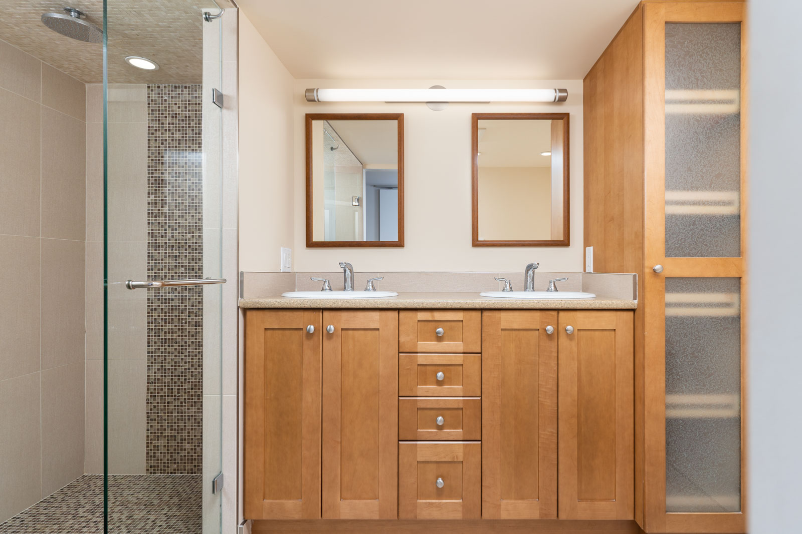 Beautiful wood finishing in the bathroom with his/her sink