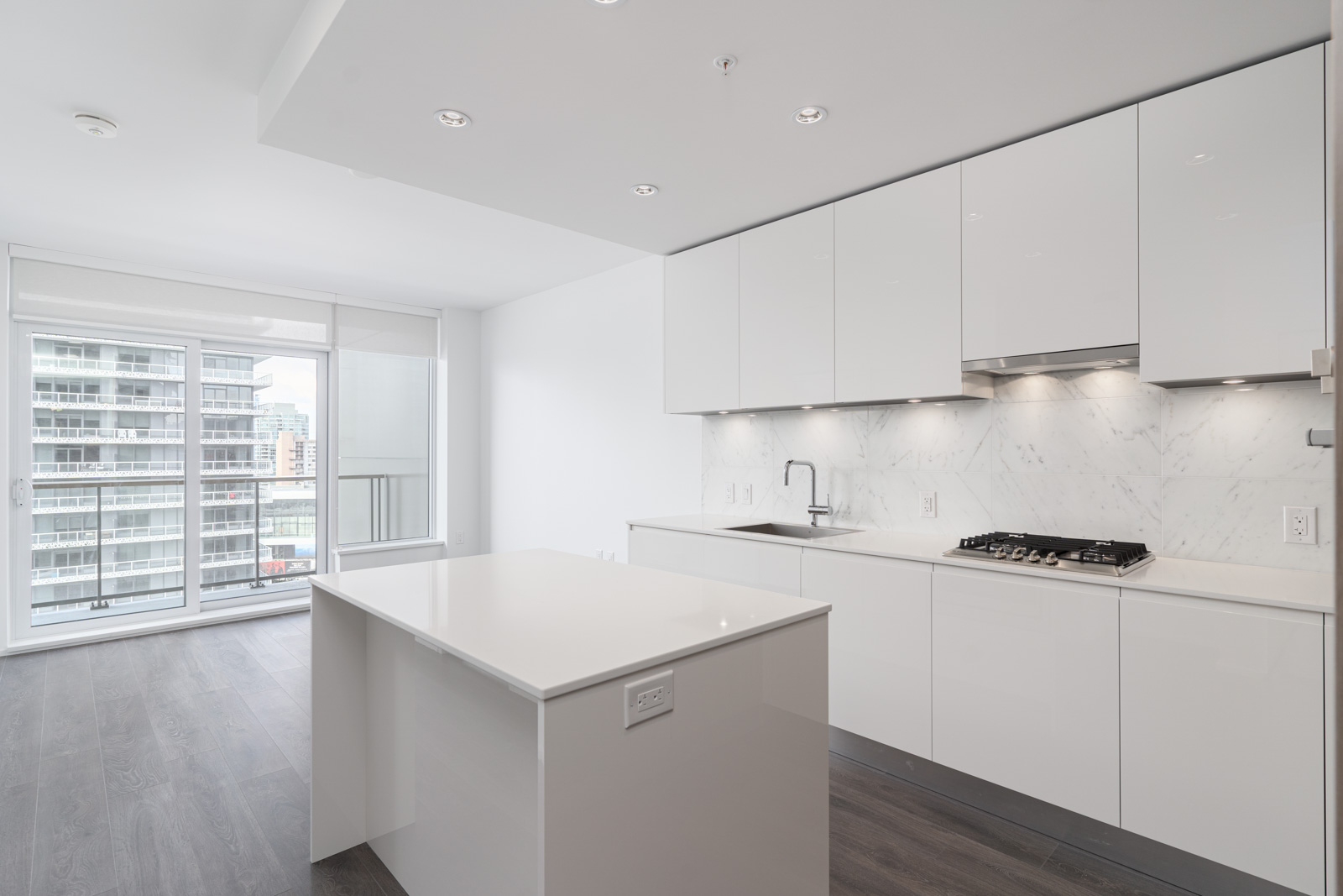 White furnishing around the kitchen for a clean and sleek living experience in the downtown of burnaby
