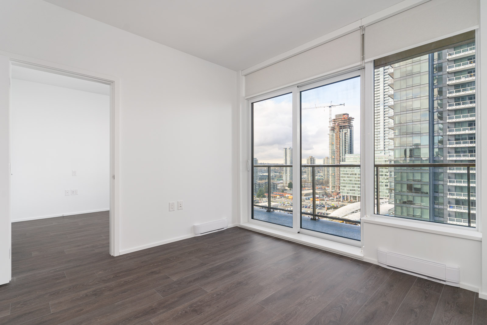 Spacious living room with plenty of sunlight overlooking the city of burnaby in metro vancouver