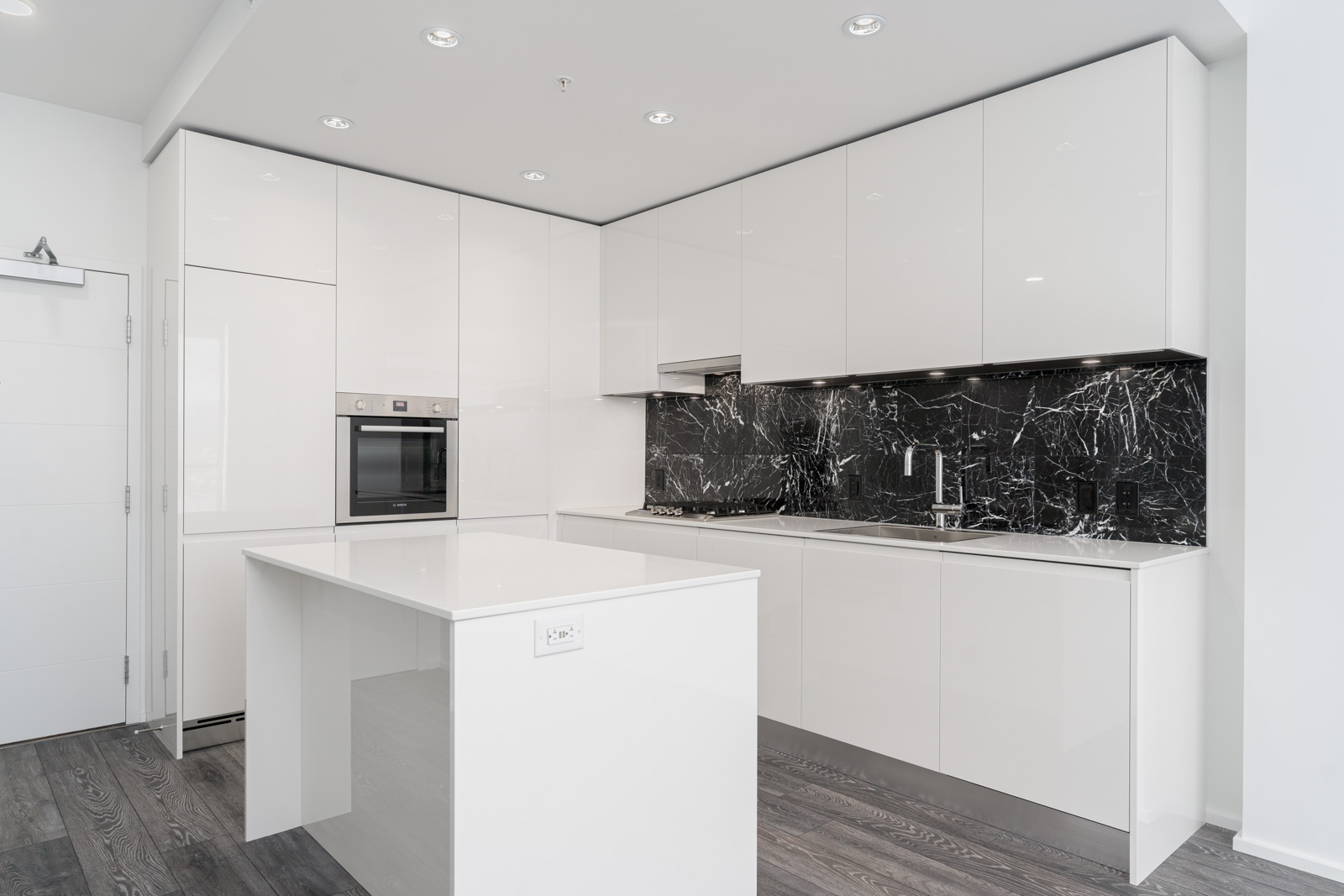sleek and polished kitchen with white funishing in amazing brentwood three building