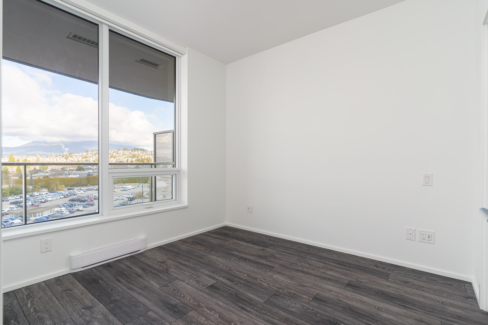 bedroom with white walls and window in rental condo in the Brentwood neighbourhood of burnaby