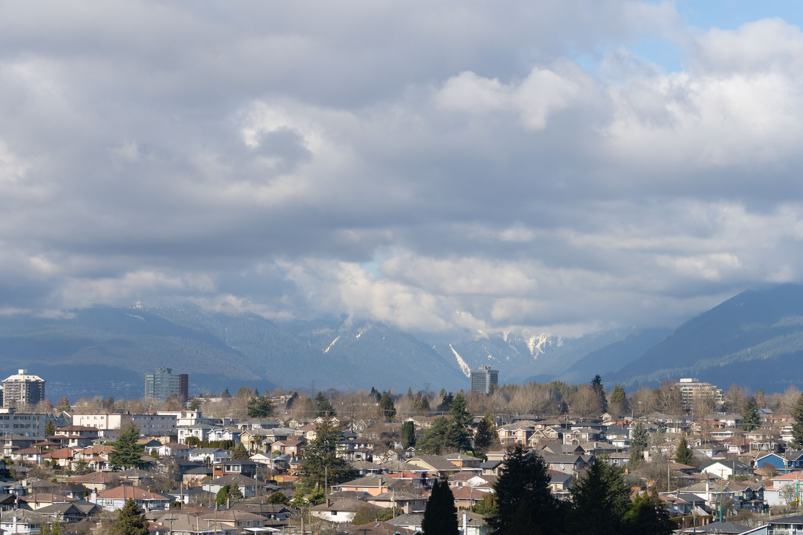 beautiful view of the mountains in the city of vancouver managed by birds nest properties