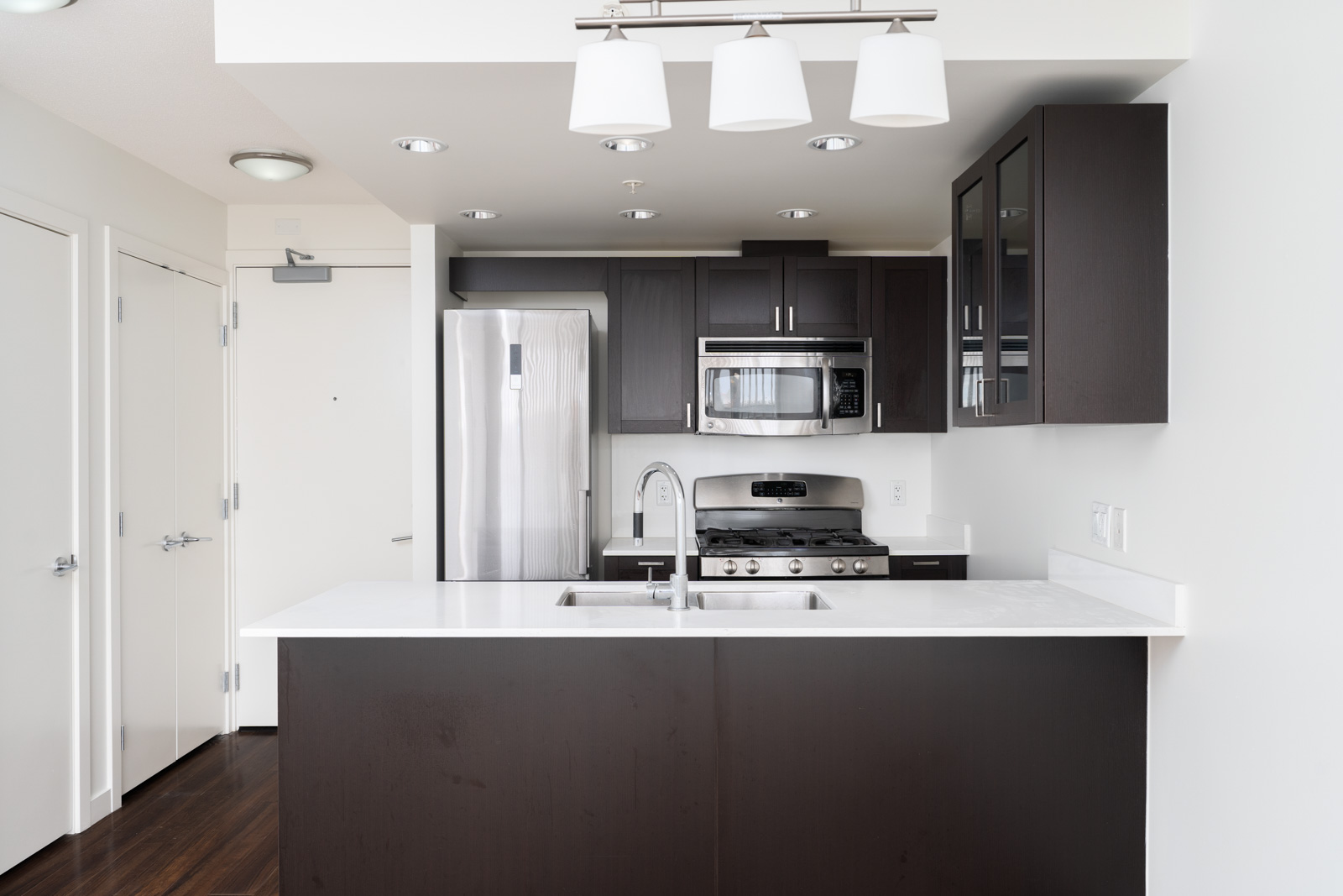 Kitchen fully equipped with high end appliances in rental condo in the slocan neighbourhood of vancouver