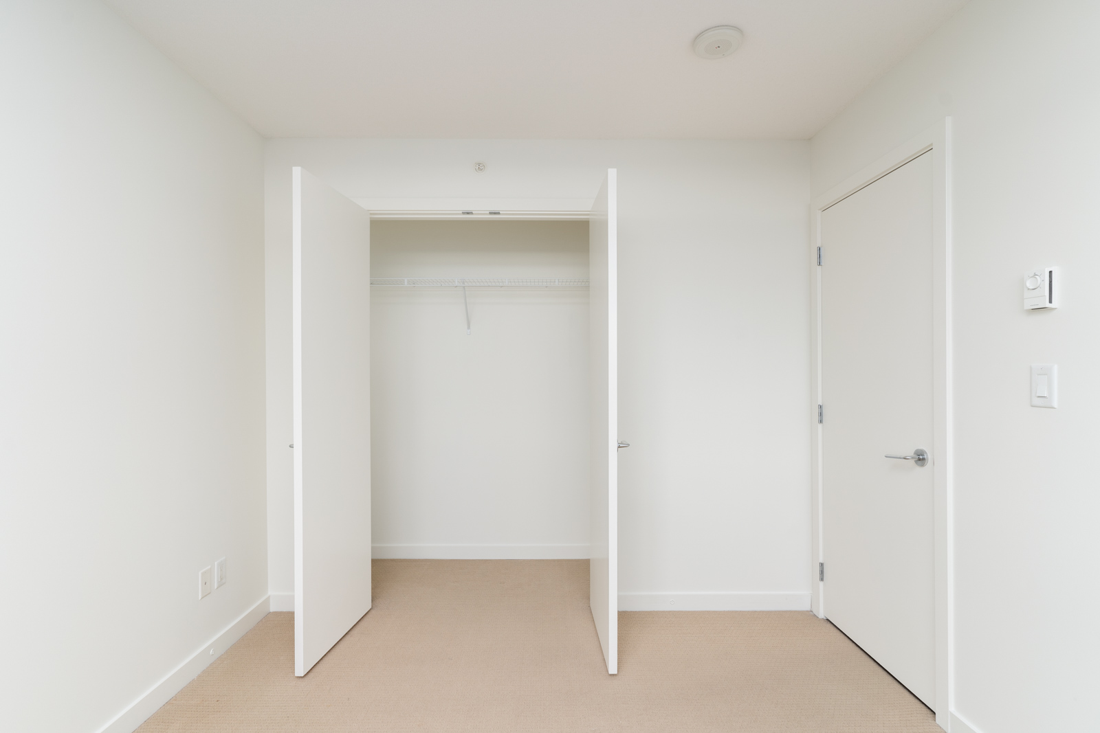 walk-in closet in rental condo managed by Birds Nest Properties