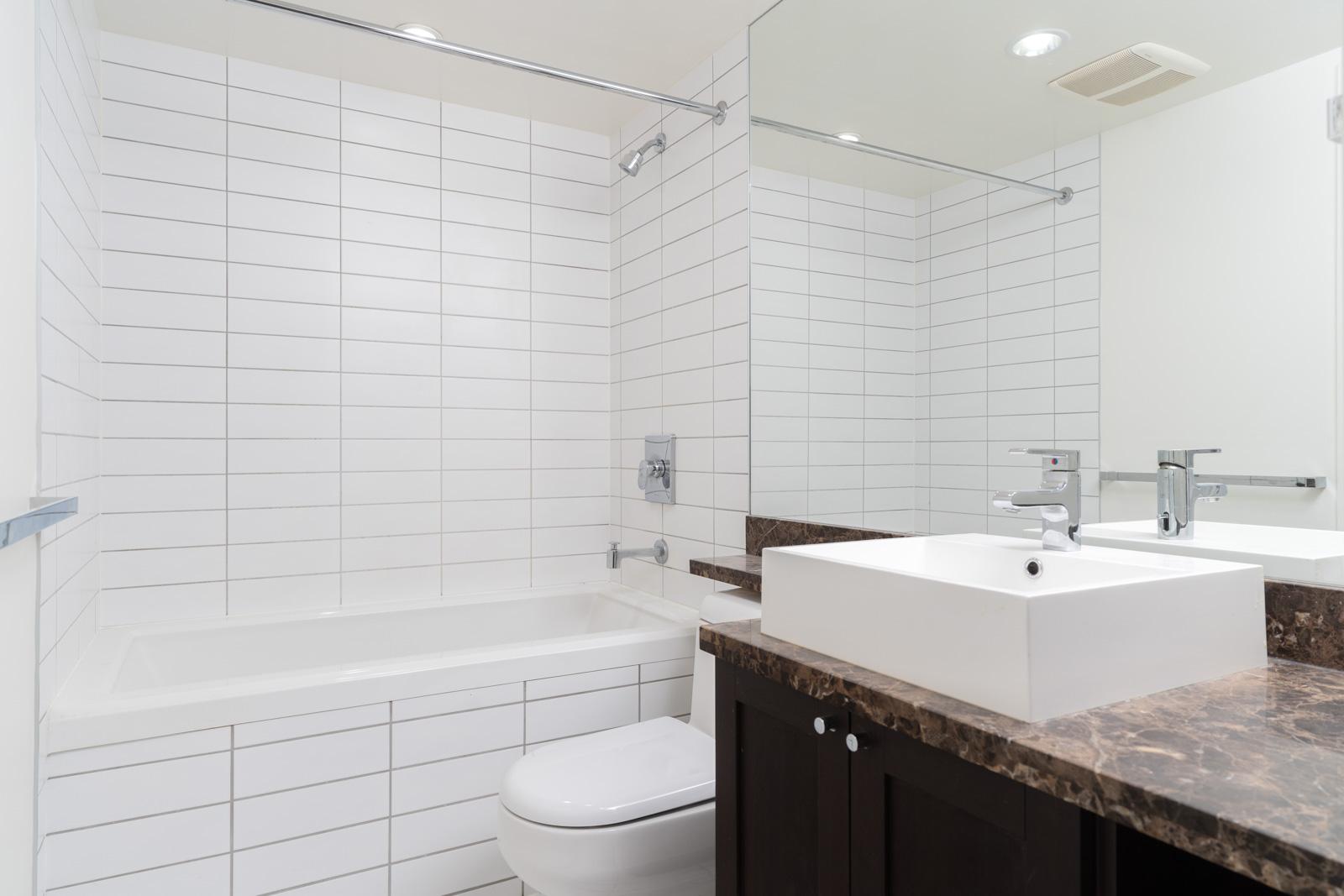 Bathroom with white walls and bathtub