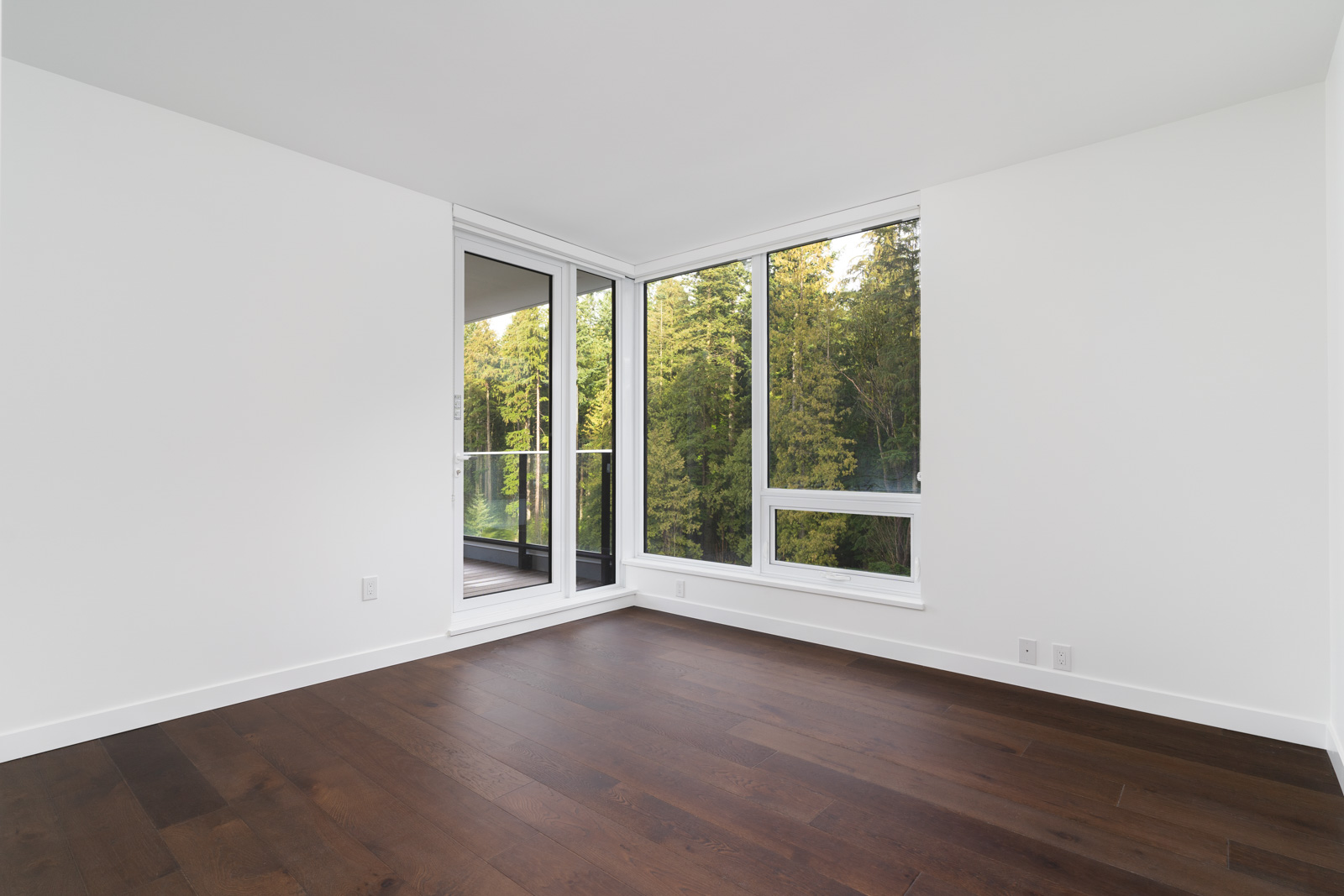 white walls with hard wood flooring at wesbrook neighborhood in Vancouver