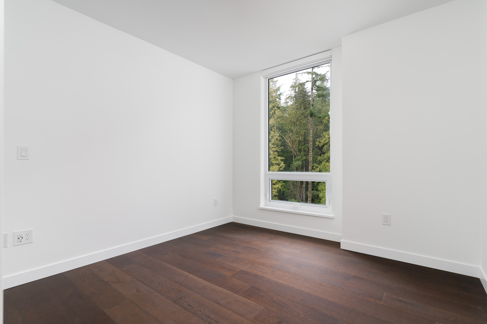 bedroom with white walls in rental house in the wesbrook vancouver neighbourhood