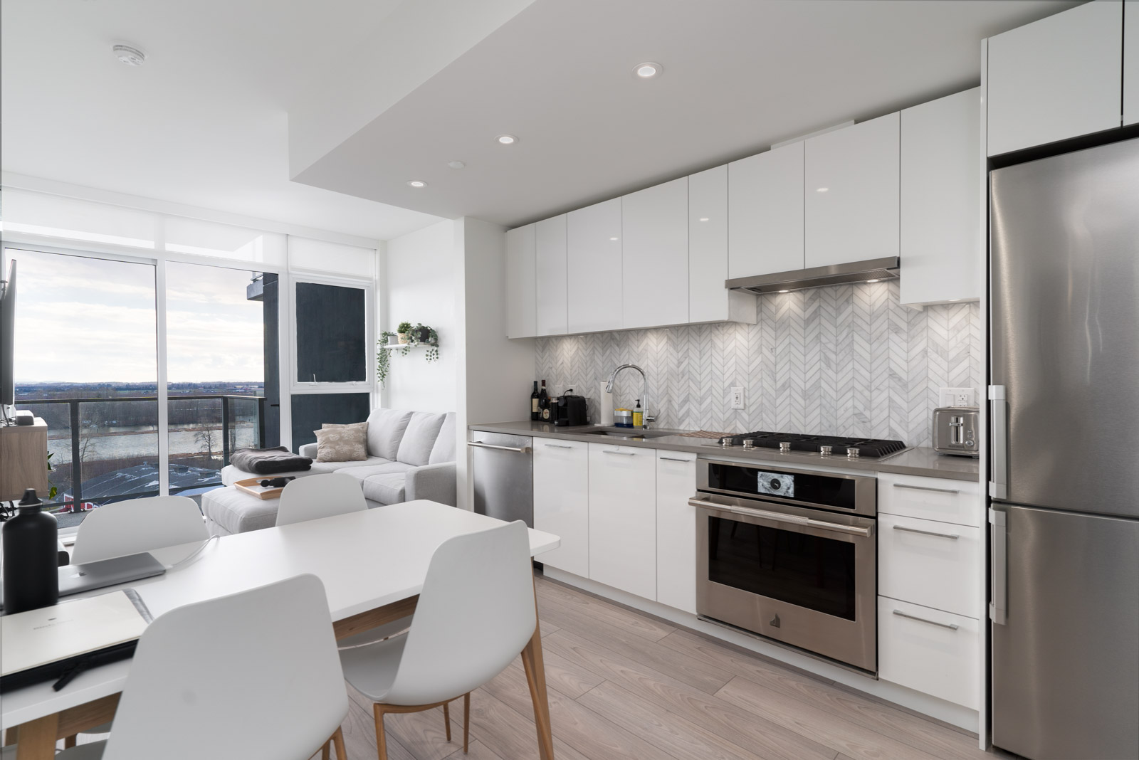 kitchen and living room view with laminate flooring in rental condo in the River District vancouver neighbourhood