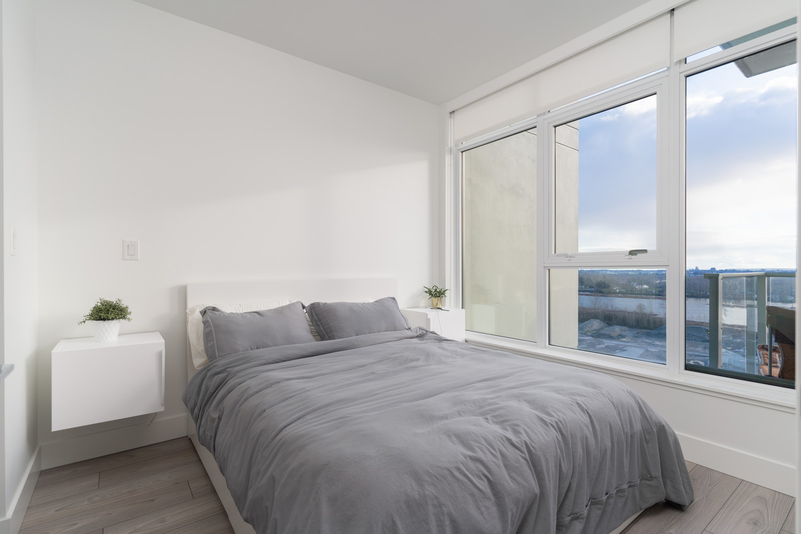 bedroom with white walls in rental house in the River District vancouver neighbourhood