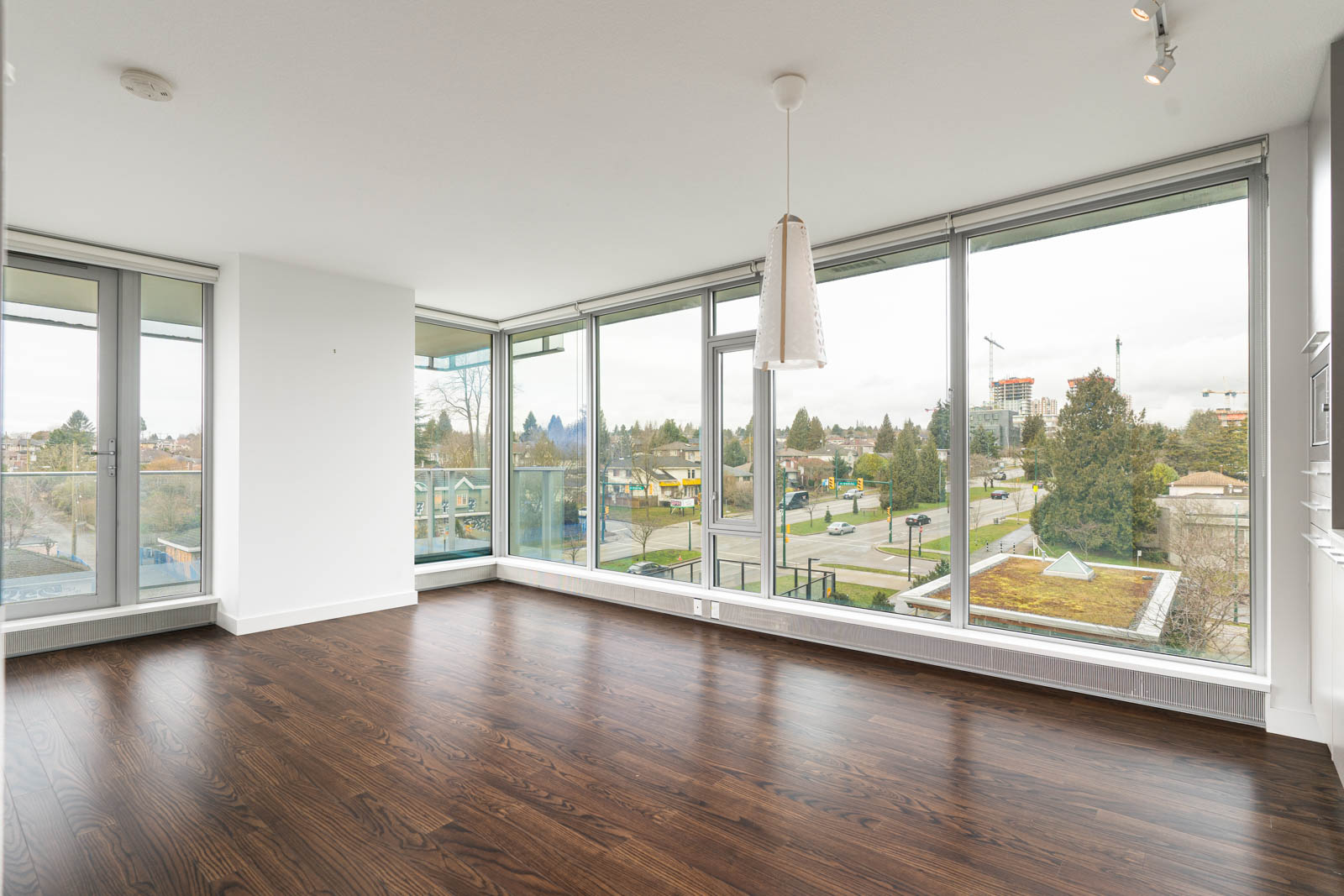 living room with laminate floors in rental house in the Marine Drive neighbourhood of Vancouver