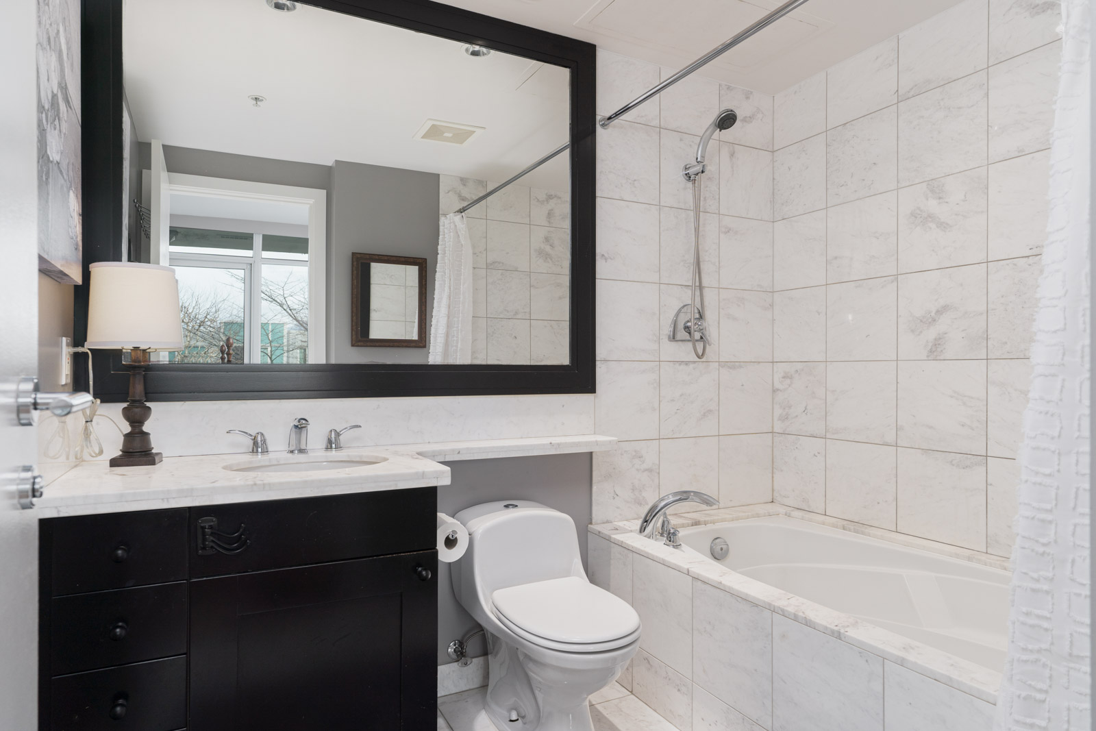 bathroom with wooden floor in rental house at Downtown neighbourhood of Vancouver