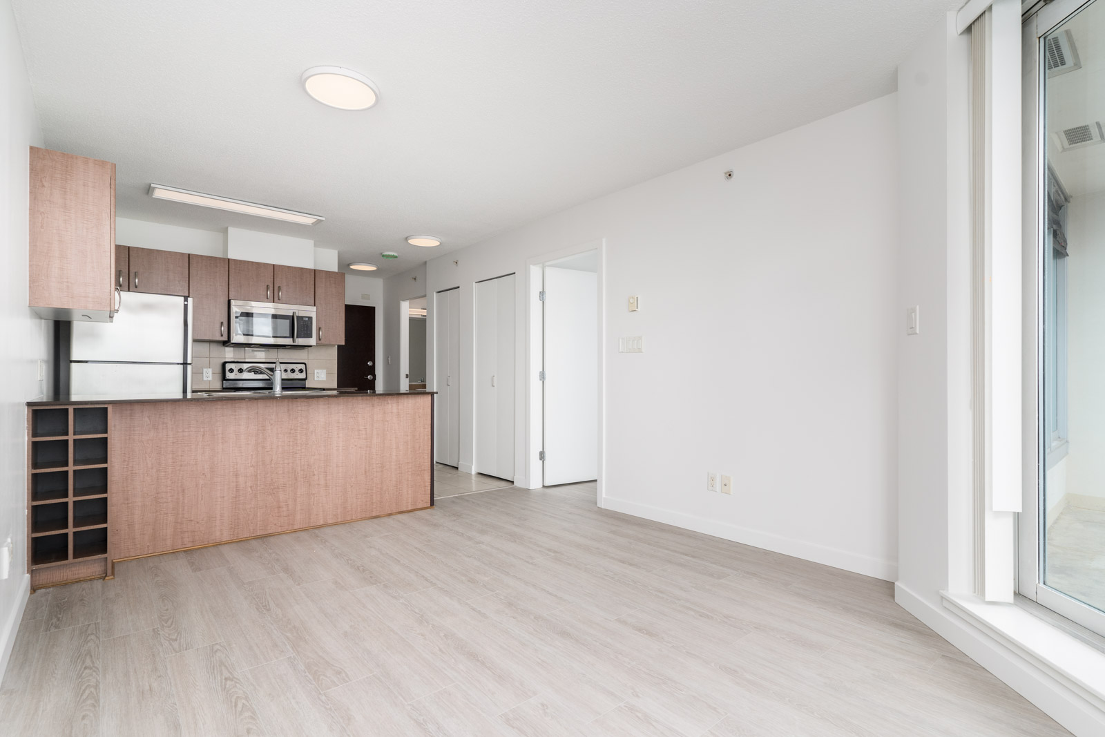 open concept floor plan with direct access from the living room to the kitchen in condo located in downtown Vancouver