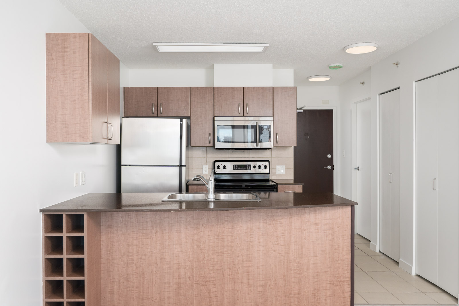 Fully equipped kitchen in a condo managed by Birds Nest Properties