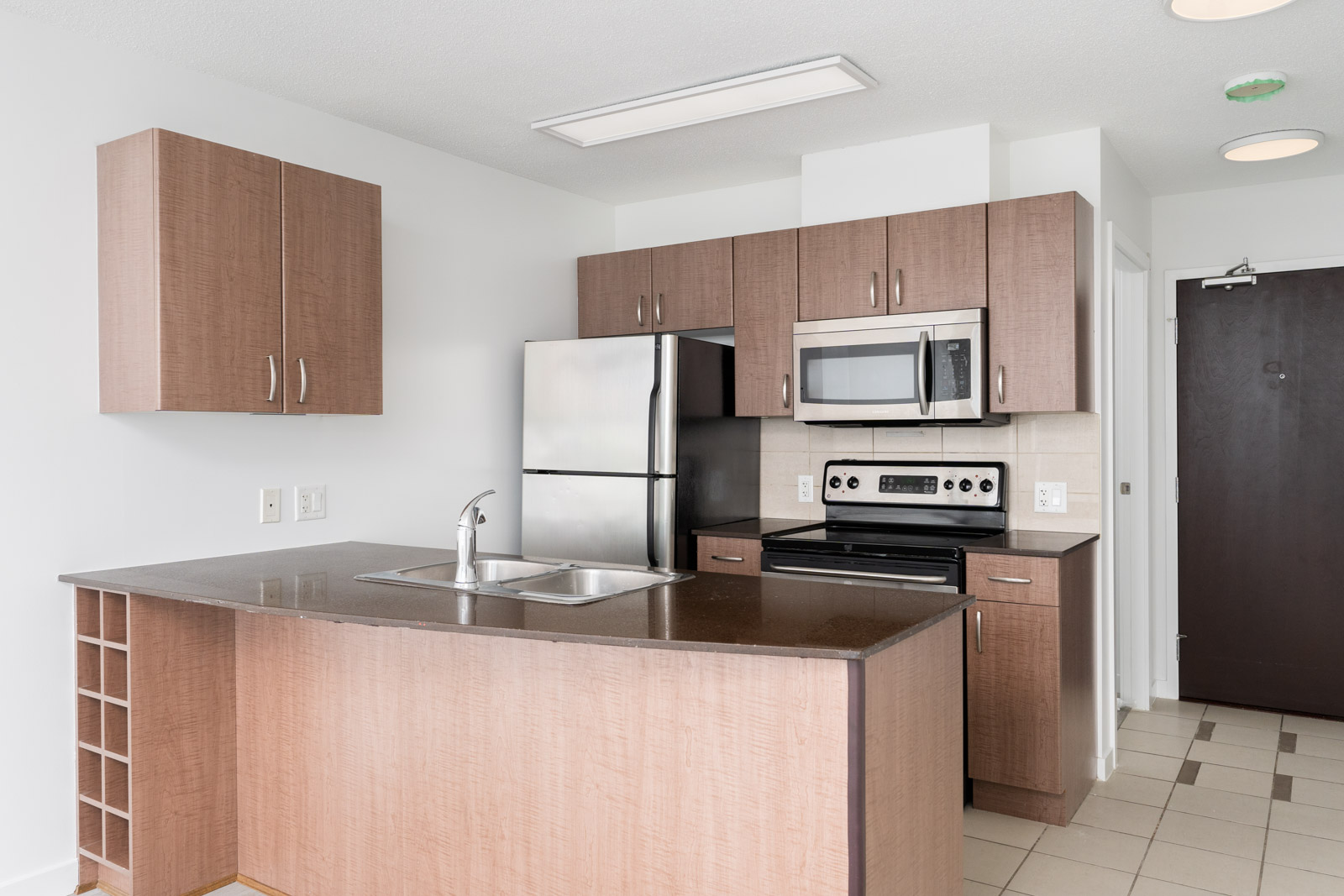 Kitchen fully equipped with high end appliances in condo managed by Birds Nest Properties