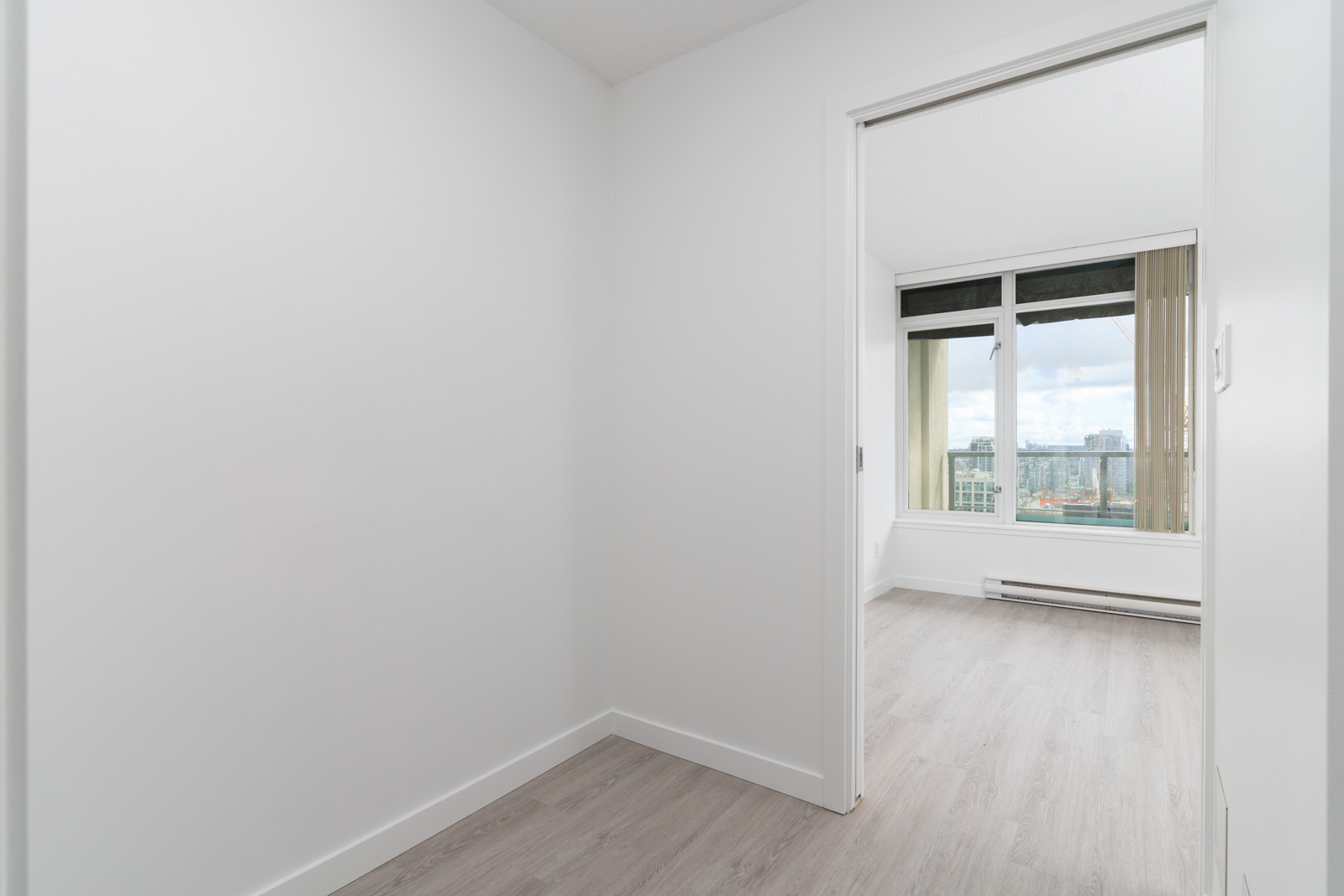 walk-in closet in bedroom in high end condo downtown Vancouver