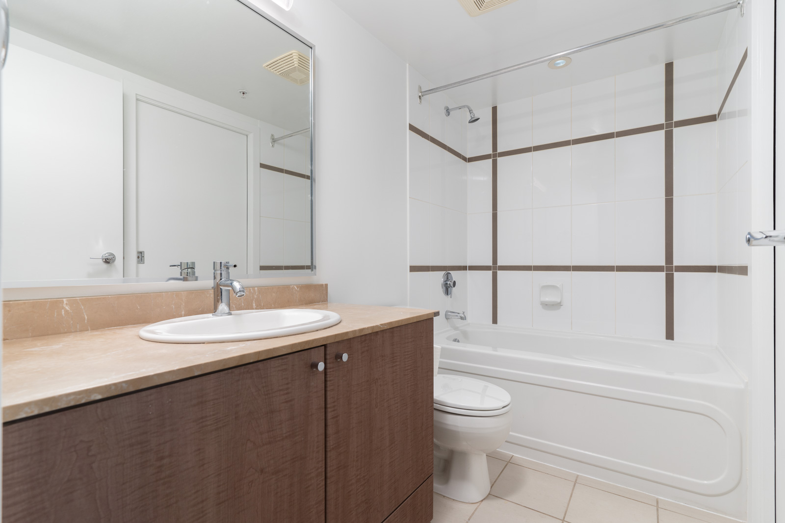 bathroom with wood finishing and white tub in condo downtown