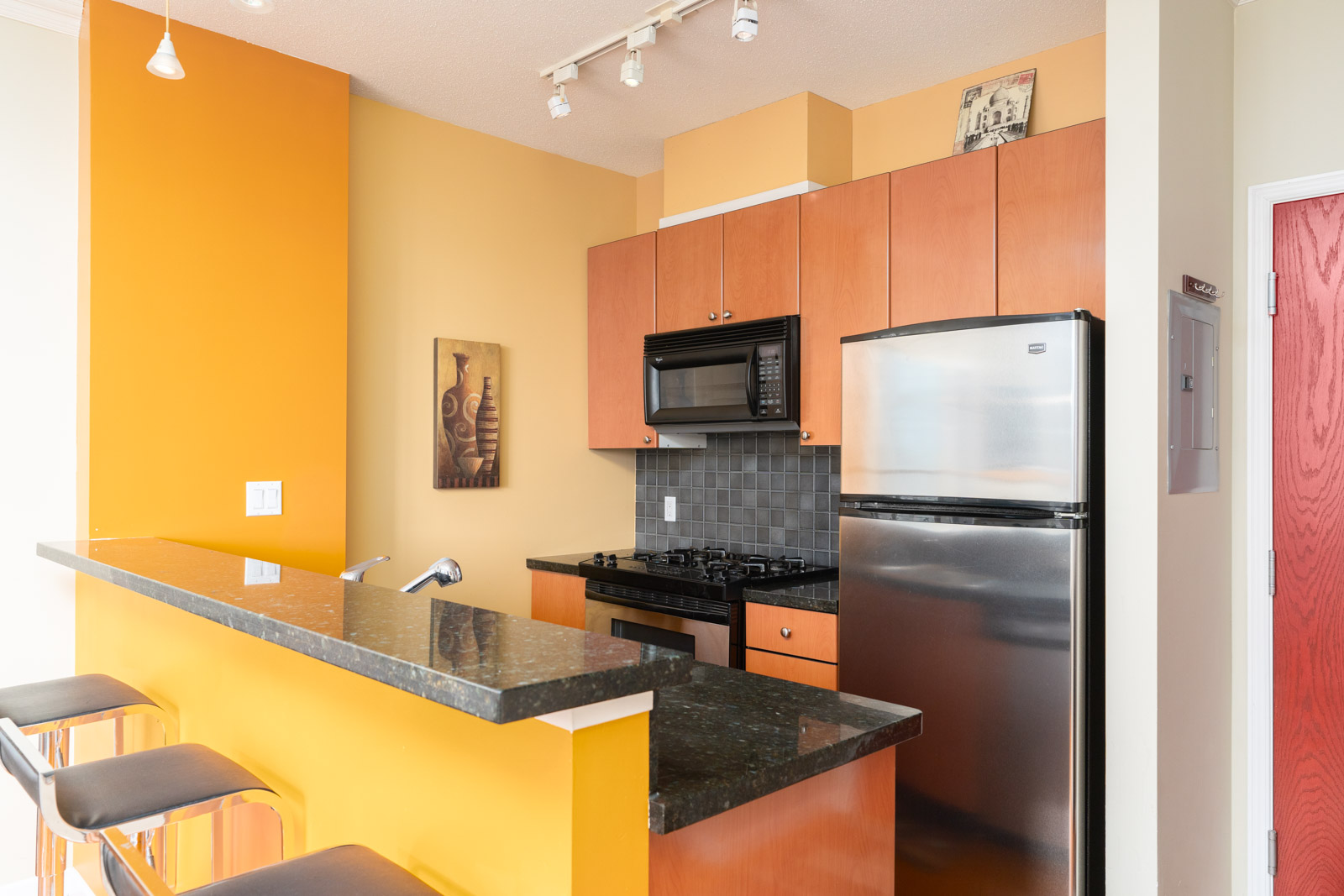 kitchen fully equipped with basic amenities in downtown vancouver
