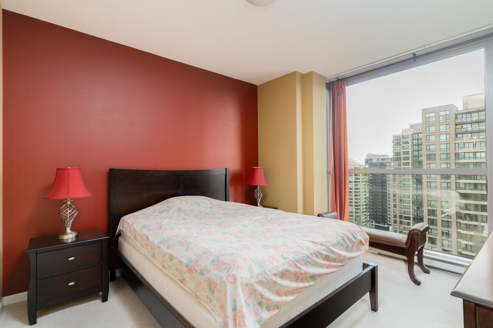 bedroom with white walls and window in rental condo in the downtown vancouver