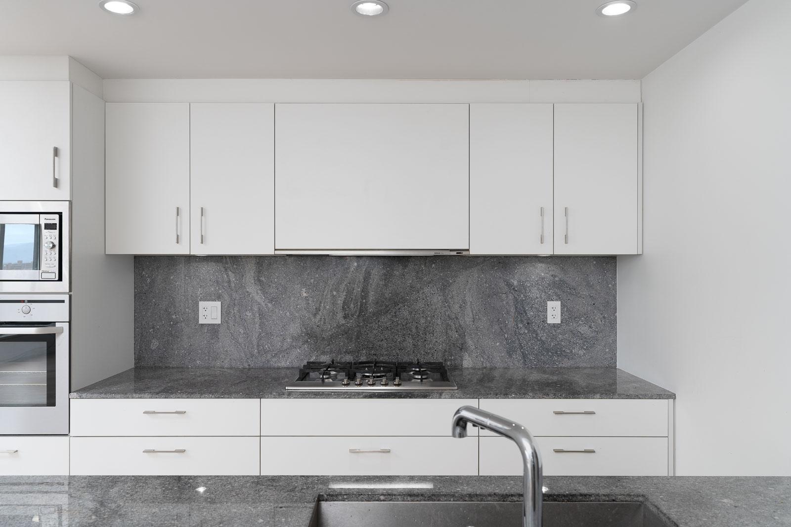 kitchen with black marble backsplash