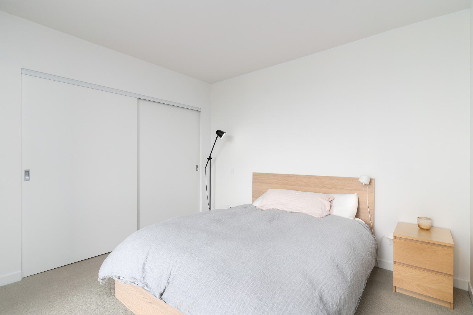 bedroom in Fairview condo with white walls