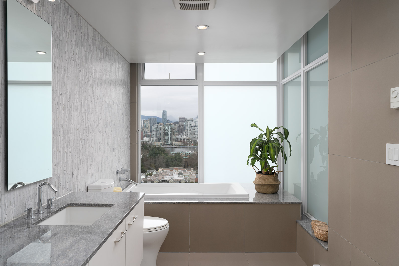 bathroom in high-end condo with view to Downtown Vancouver