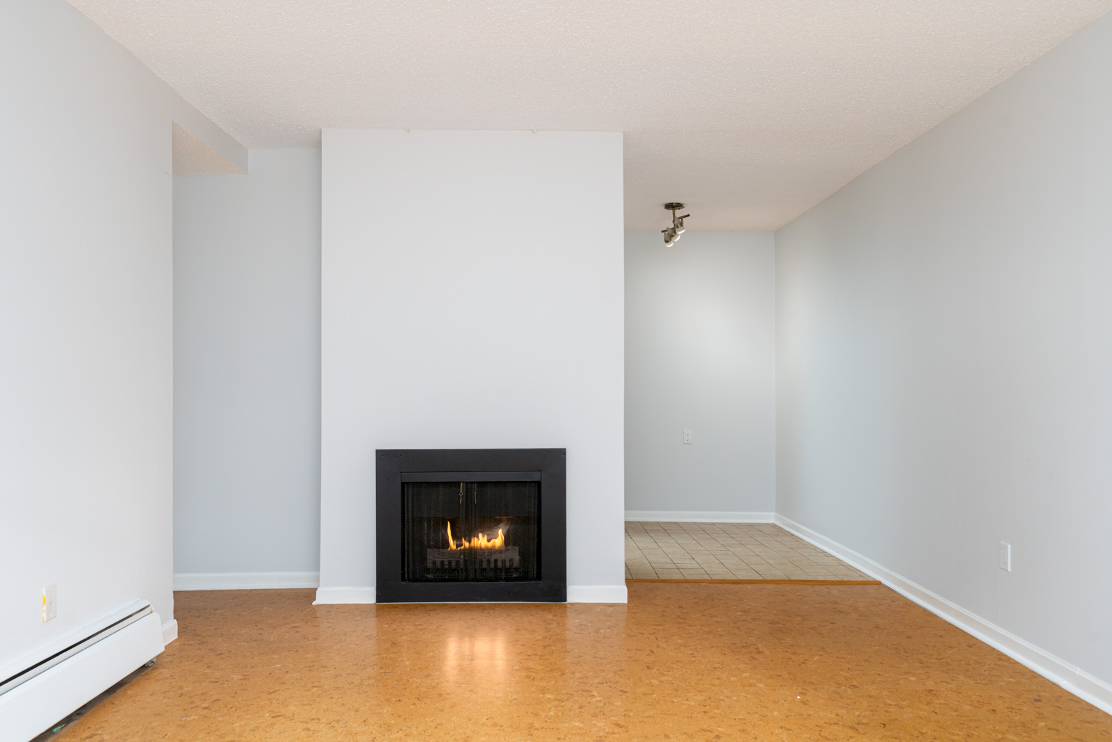 living room with white walls near cozy fireplace in mount pleasant