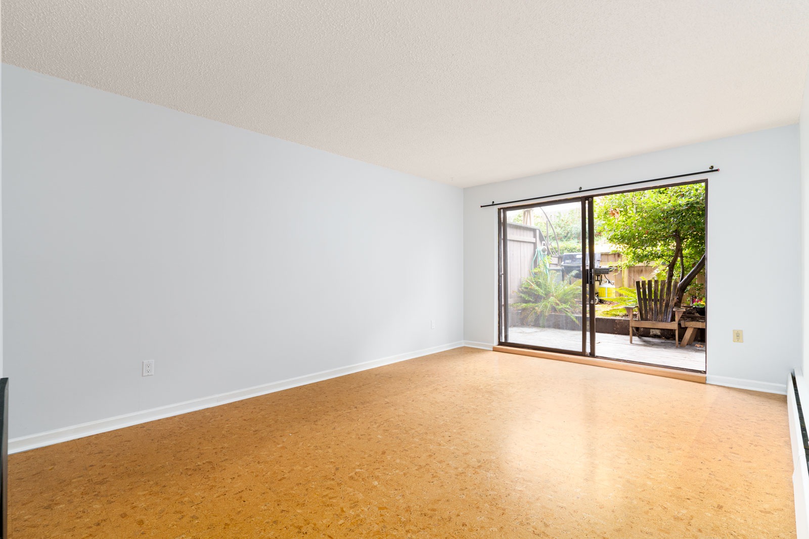 spacious and bright condo in landmark manor with large backyard in east vancouver;
