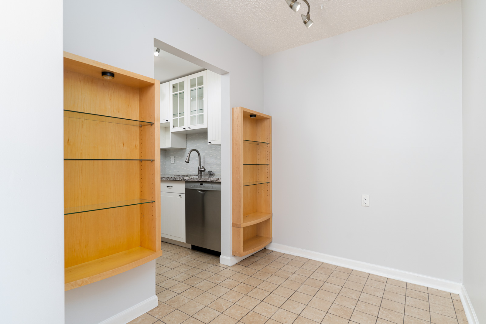 bright condo in east vancouver in mount pleasant neighborhood with white walls and dishwasher