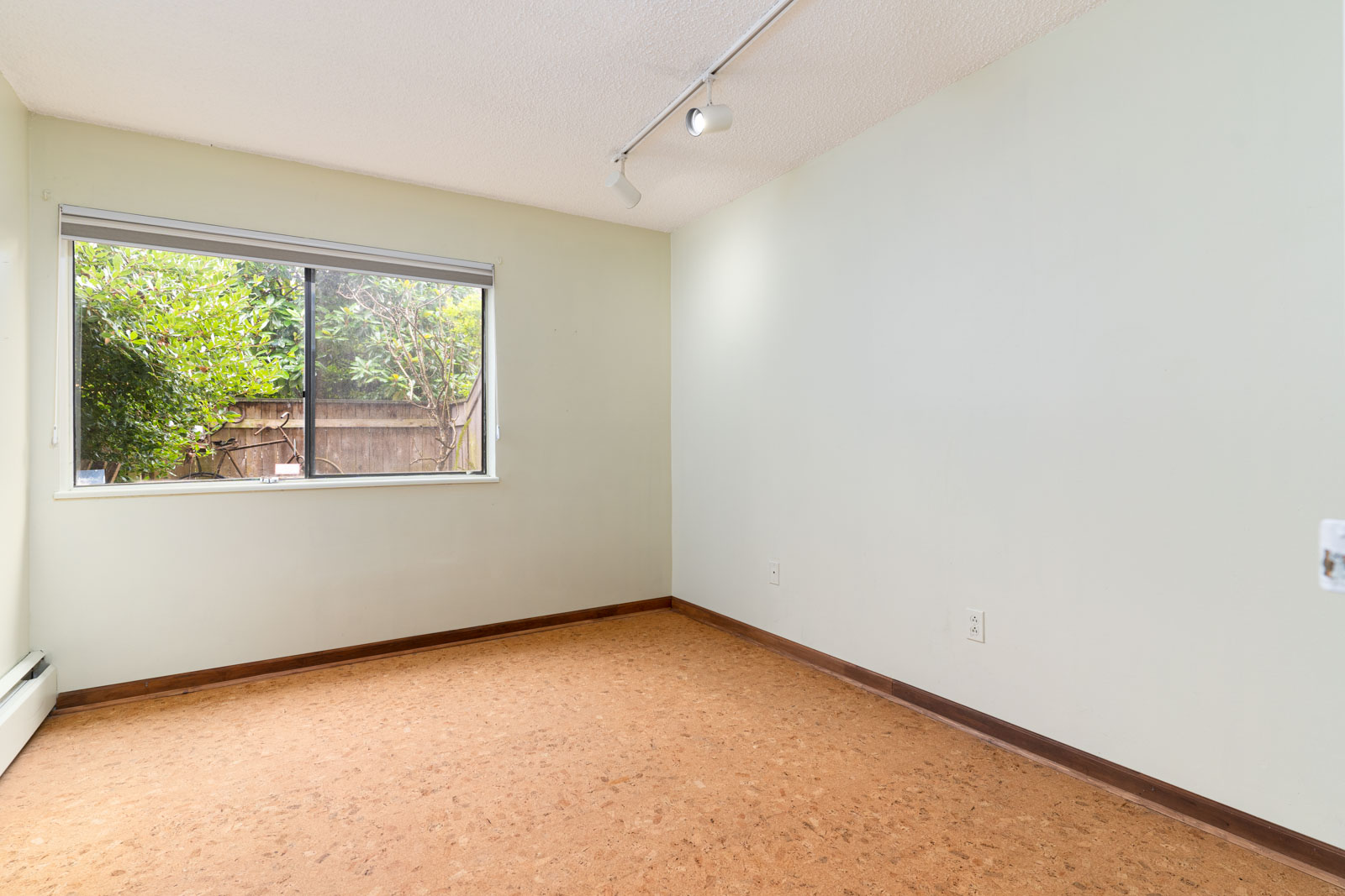 spacious living room in condo located in vancouver in mount pleasant neighborhood