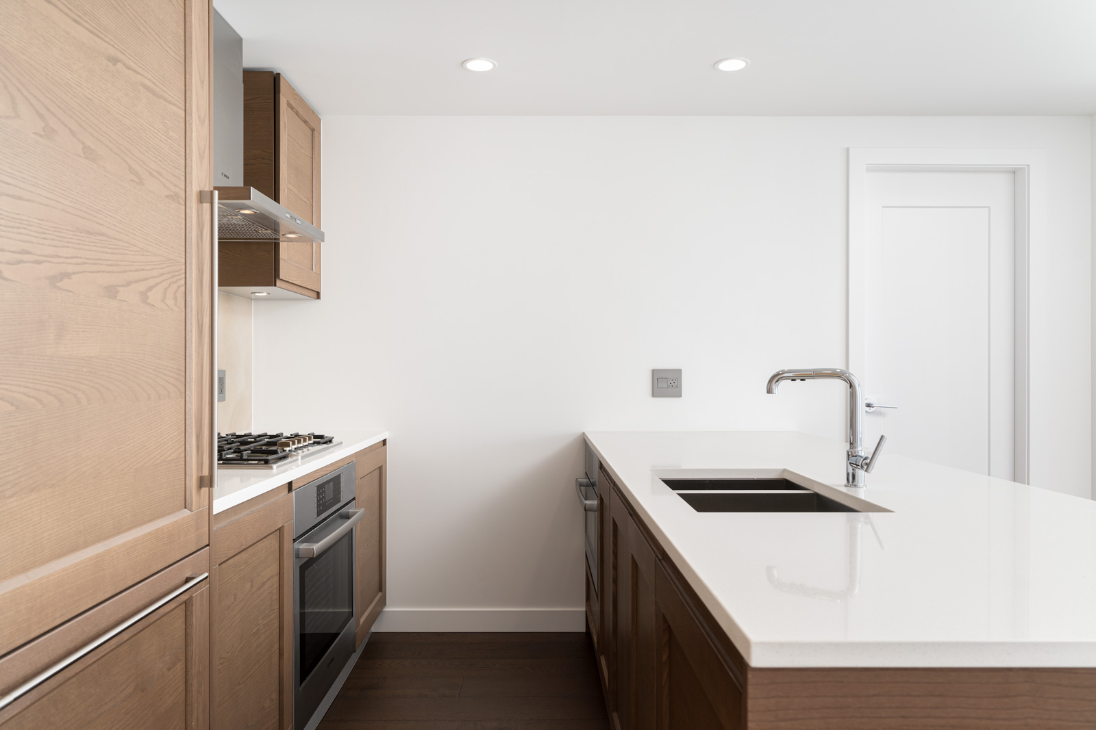 new kitchen by Birds Nest Properties at Ivy at the Park by Wall Financial at UBC neighborhood in Vancouver