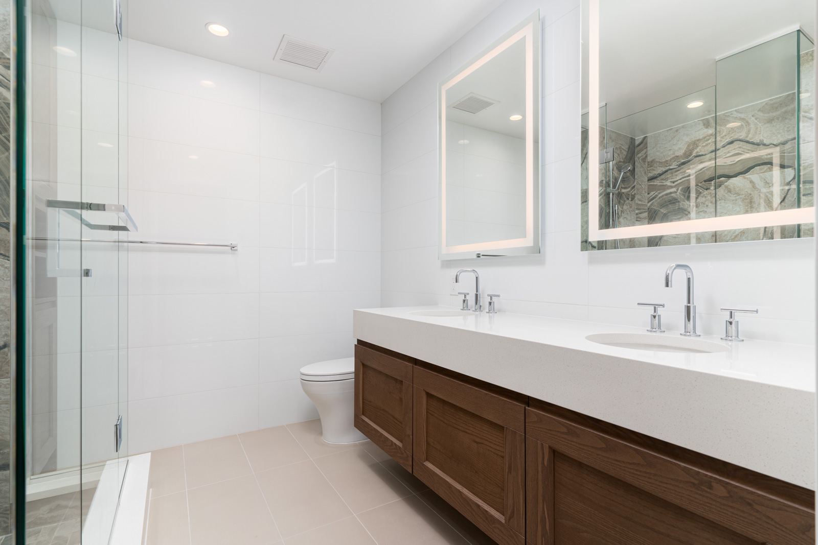 master bathroom with white stall in the rental condo at ivy at the park in vancouver near university of british columbia