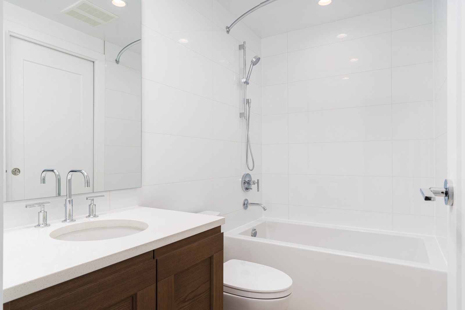 bathroom with white stalls in a rental condo in vancouver at ivy at the park near university of British Columbia