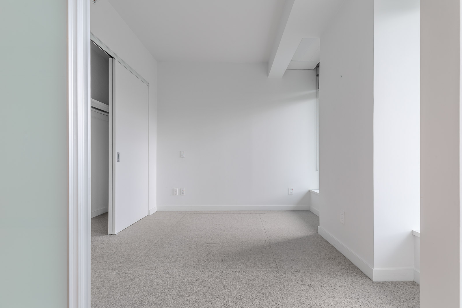 bedroom with white walls and spacious closet