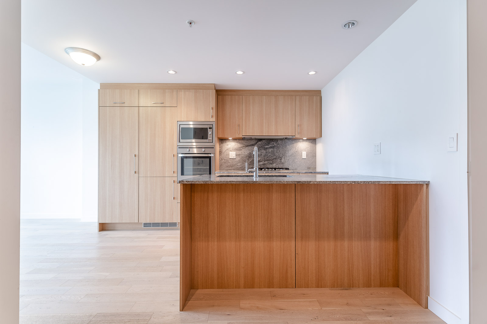 bright kitchen with custom cabinets at 700WEST8TH