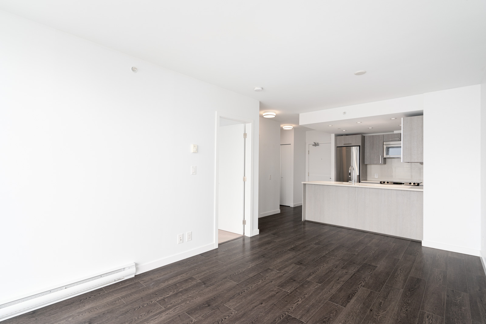 laminate floors in the bright living room with white walls in vancouver the heatley at strathcona village