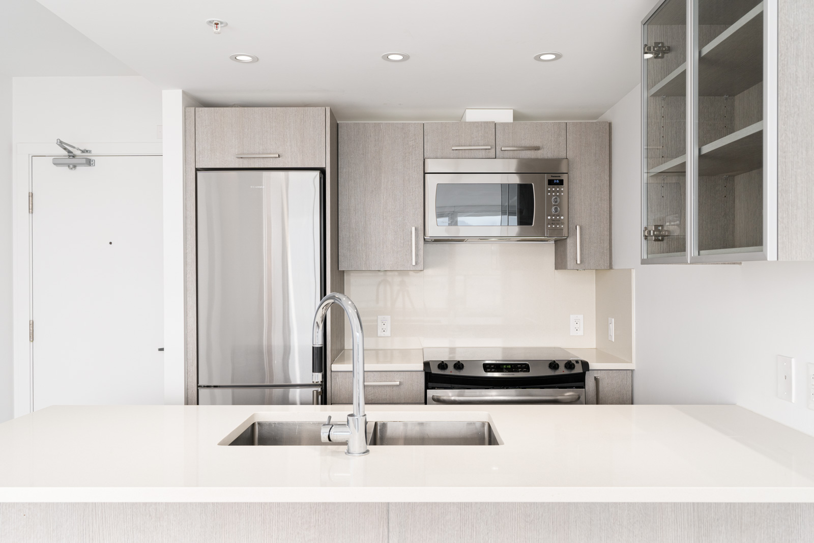 modern kitchen with white granite countertops in the heather at strathcona village