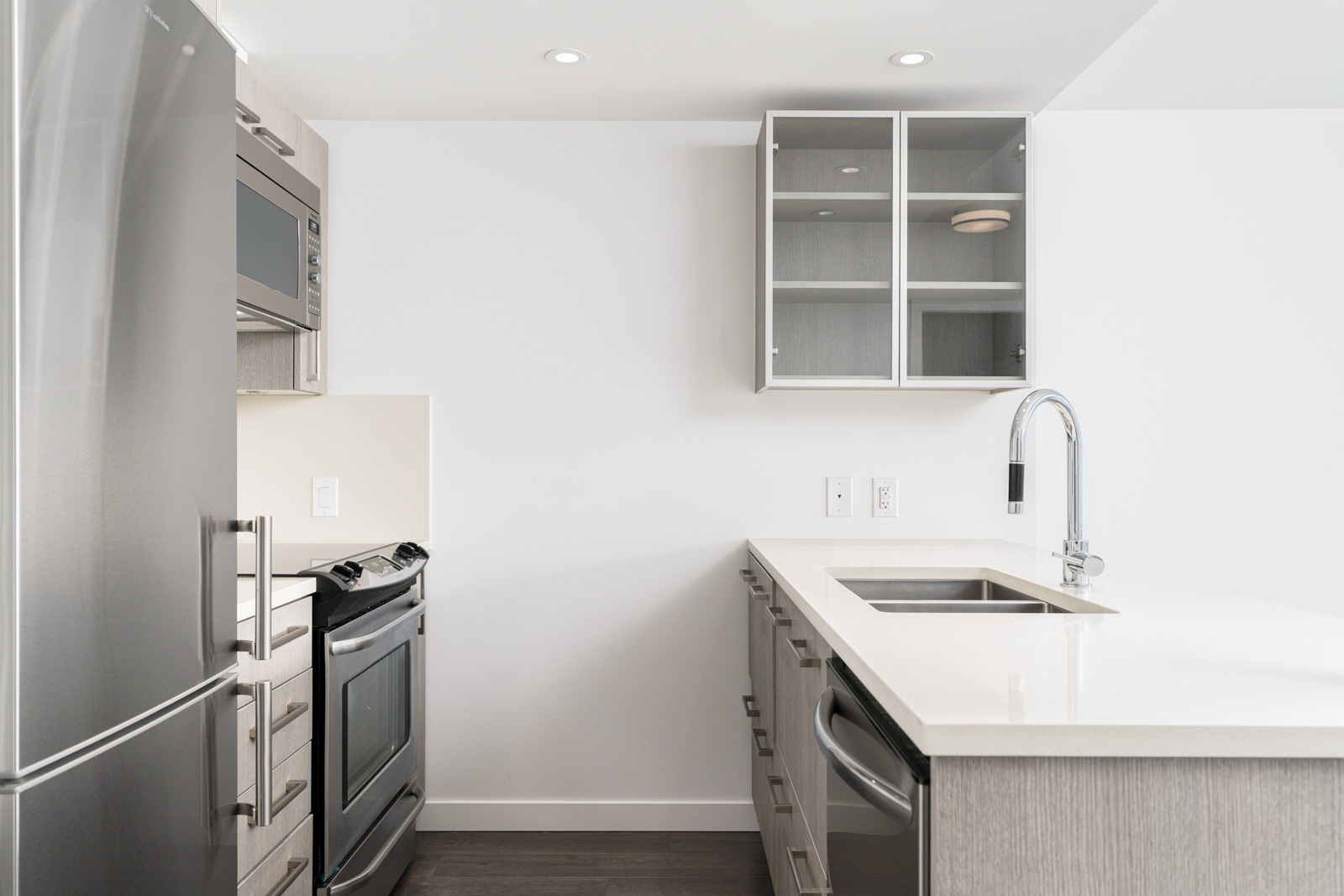 white and cream kitchen with dishwasher in downtown vancouver in the heatley at strathcona village