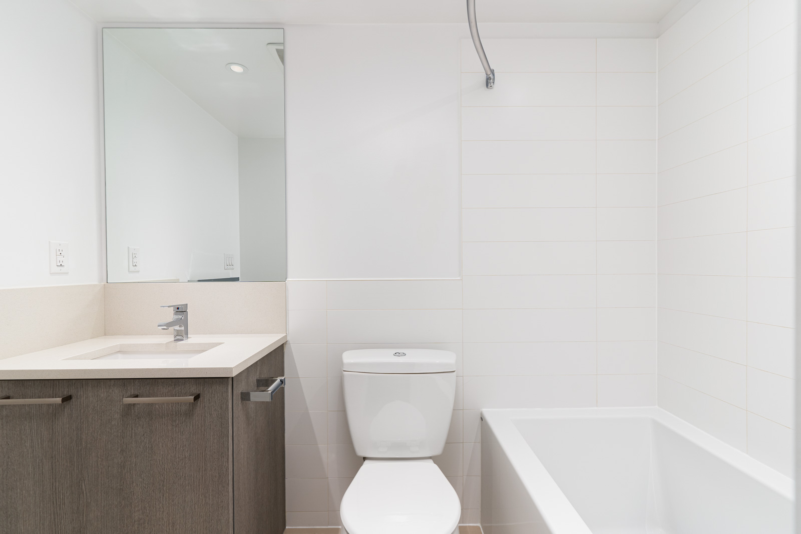 bathroom with white stall in rental condo in vancouver