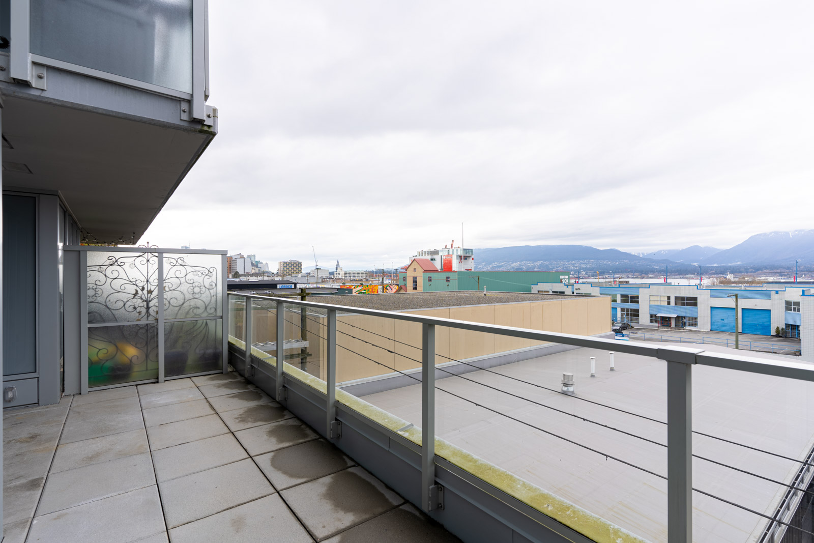 balcony with a city view of Vancouver in a rental condo in the heatley at strathcona village