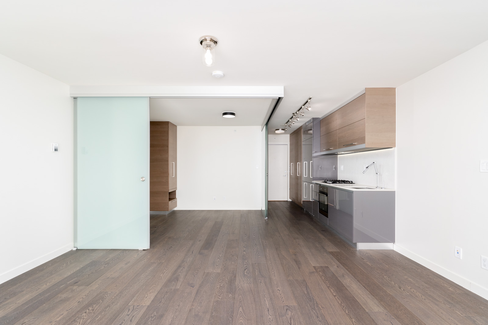 living room lead directly to the kitchen in high end condo managed by Birds Nest Properties