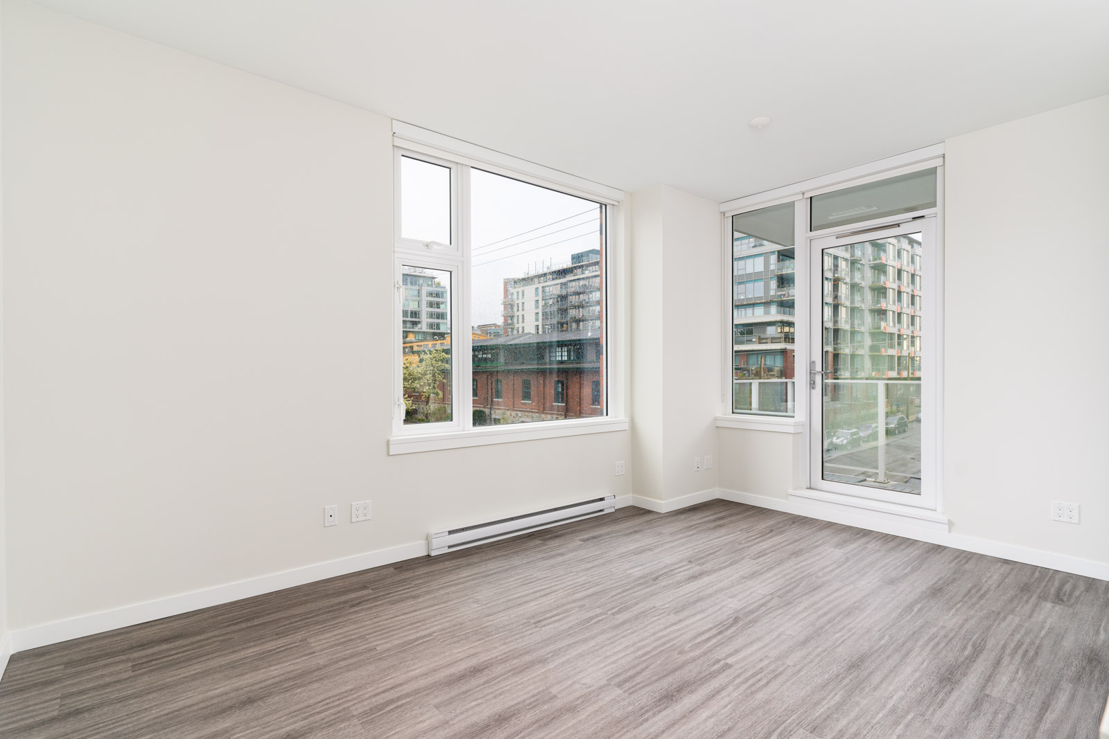 large living room with white walls in mount pleasant in a rental condo in vancouver
