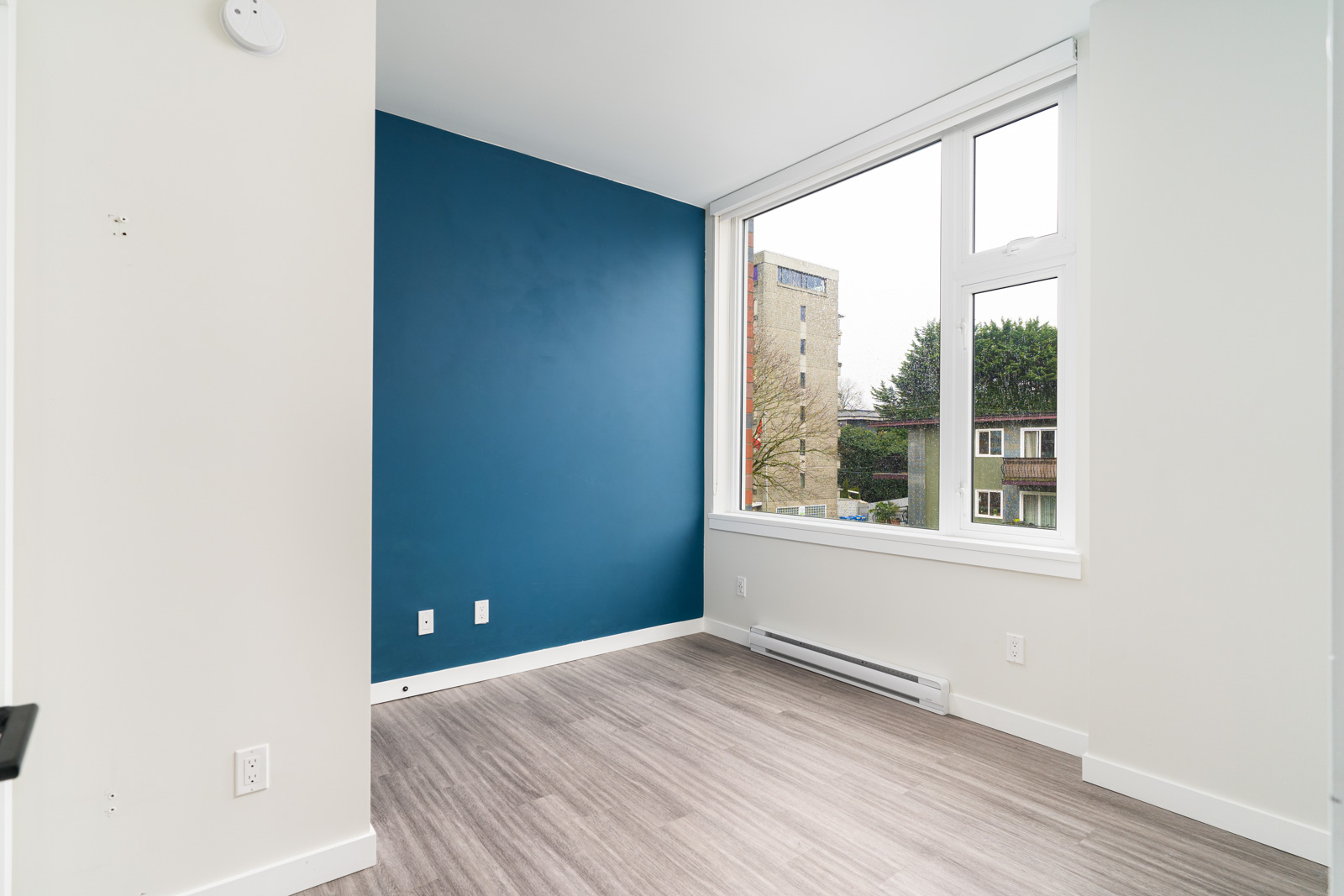 blue accent wall in a rental condo in mount pleasant with laminate floors