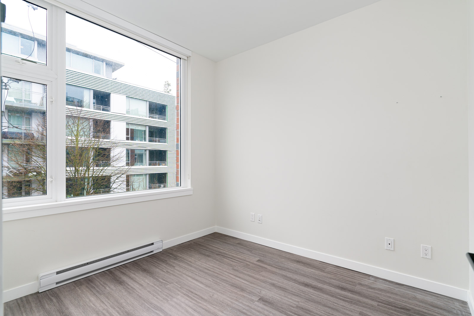 bedroom with laminate floors in a rental condo in mount pleasant in Vancouver with a view