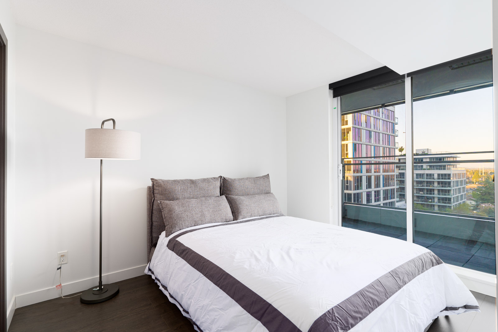 bedroom with bed, lamp and window rented in a condo in richmond