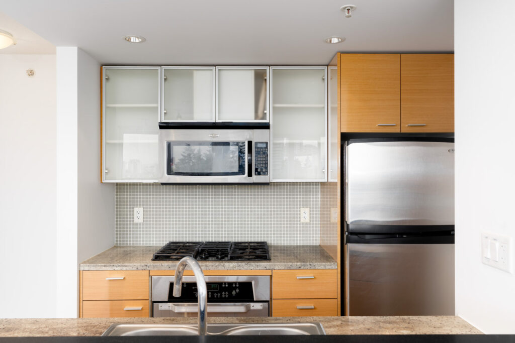 Kitchen with full fledge appliances in rental building managed by Birds Nest Properties