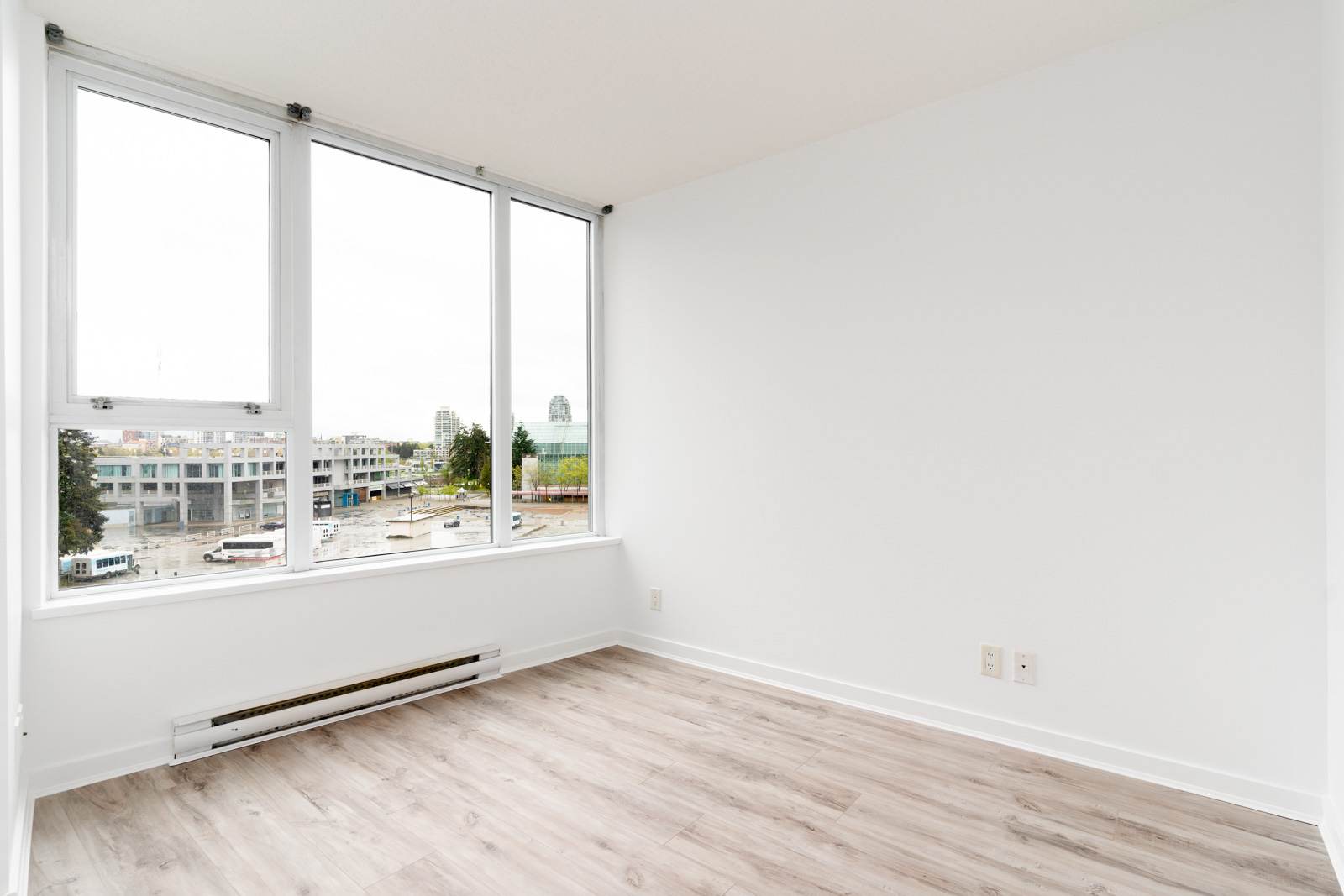 bedroom with white walls and window in rental condo in the Yaletown neighbourhood of Vancouver