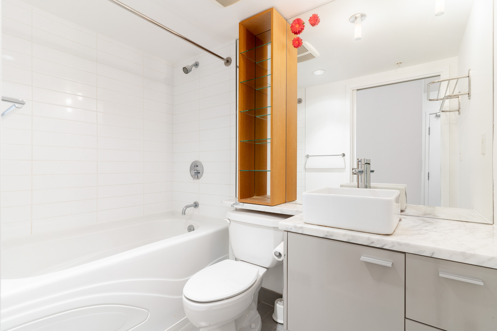 Full bathroom with white wall and tub
