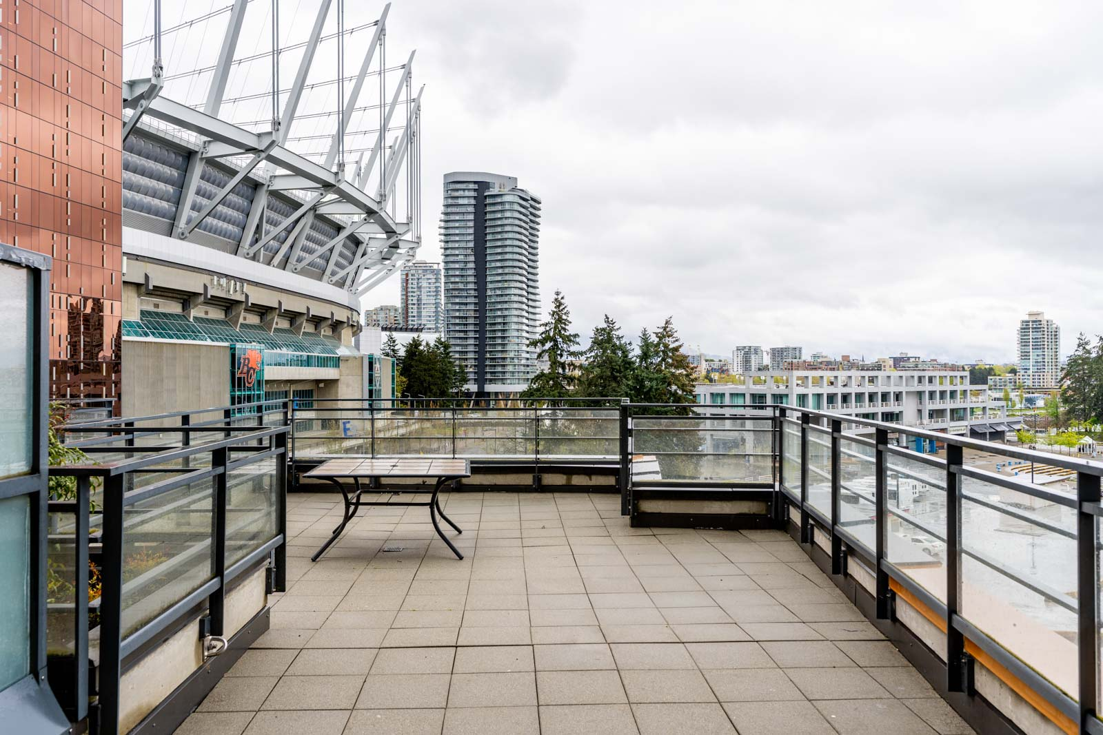 Large balcony overseeing BC Place in Vancouver