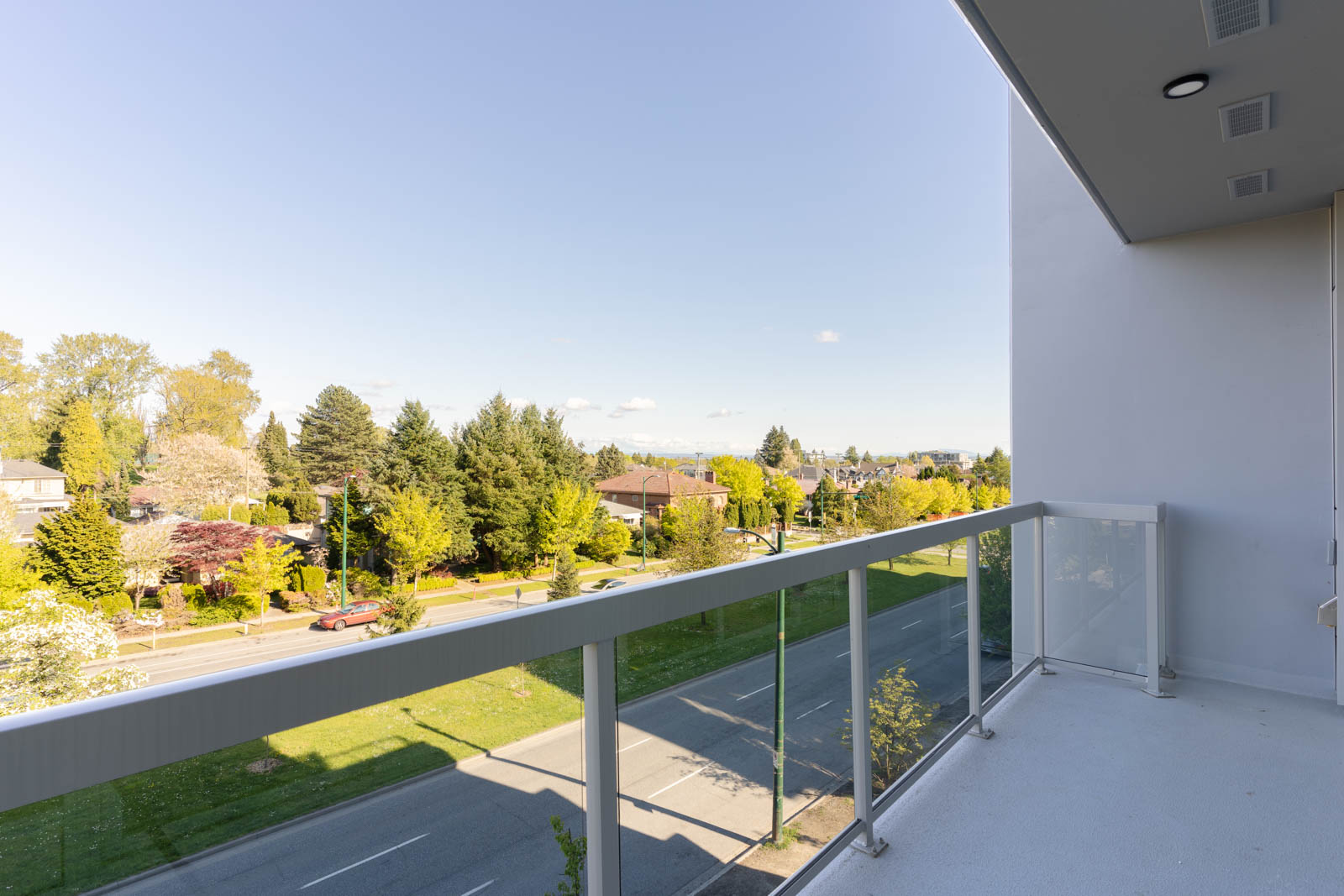 balcony with view of clear skies in rental condo in the Queen Elizabeth neighbourhood of Vancouver